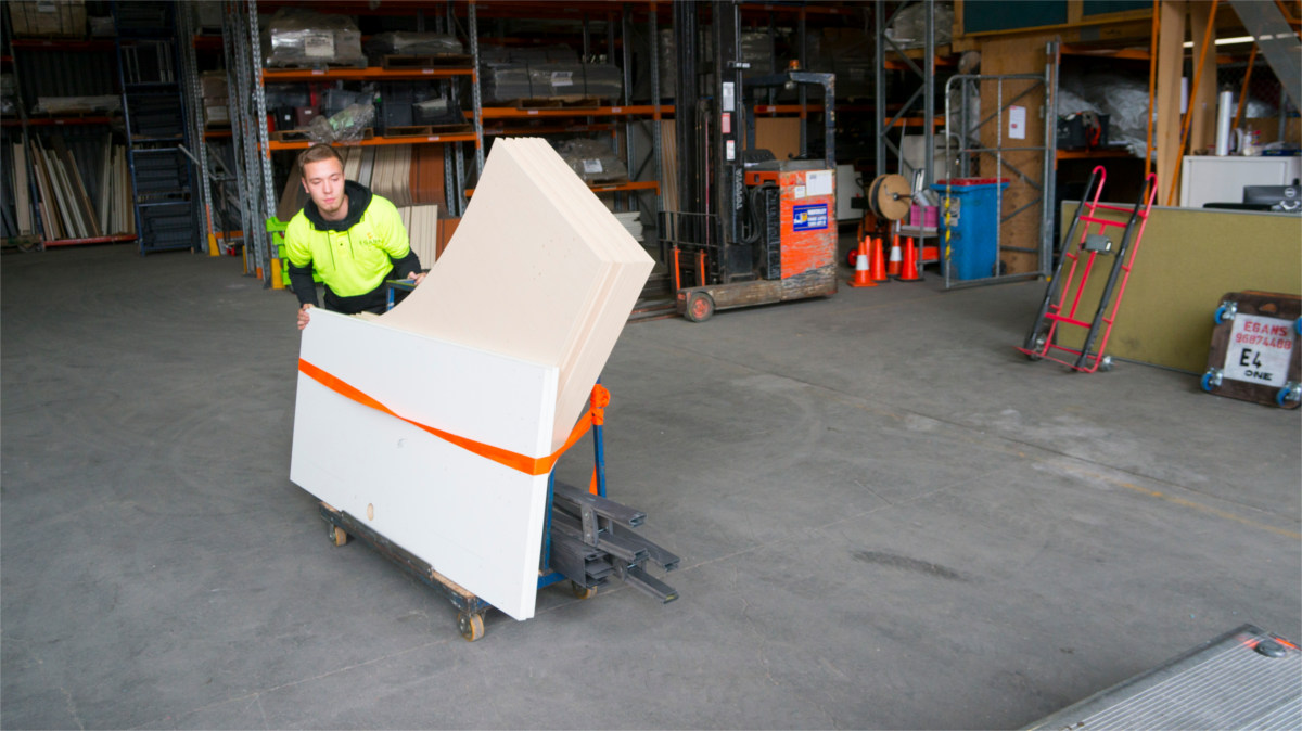 staff moving workstation table tops