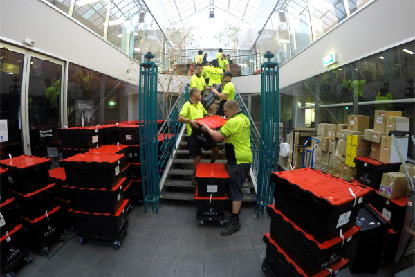Moving crates down stairs