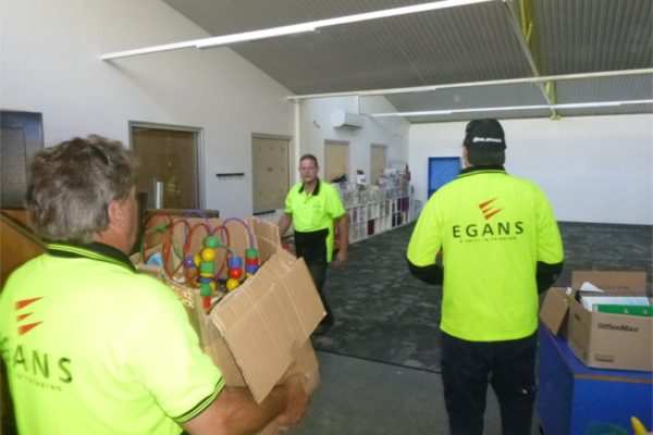 Egans staff moving boxes