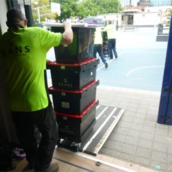 offloading crates from truck