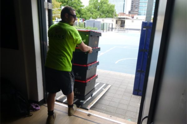 pushing crates off truck