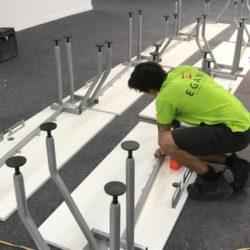 screwing workstation legs