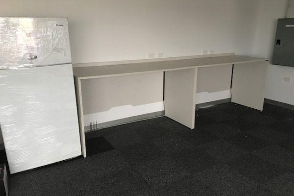 office kitchen cabinet next to fridge