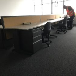 office desks with chairs and peds