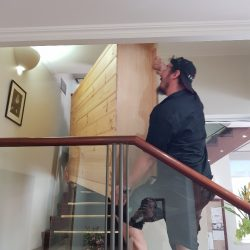 Moving furniture down the stairs