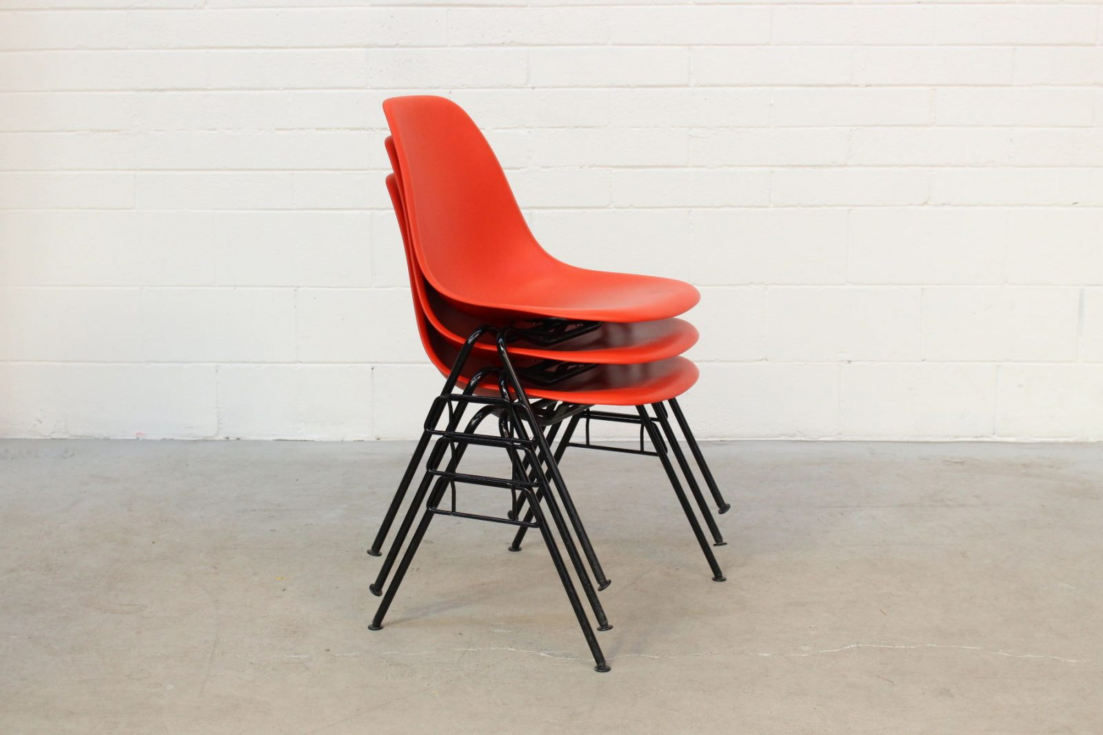 Eames DSS red Stack office chairs