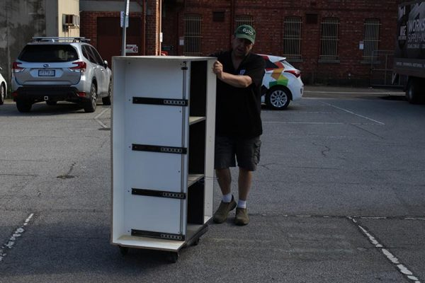 Moving storage cabinet